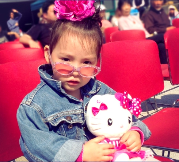Daughter listens to live rock-n-roll at outdoor concert in Osaka
